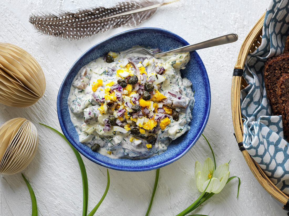 Herring salad with eggs and capers