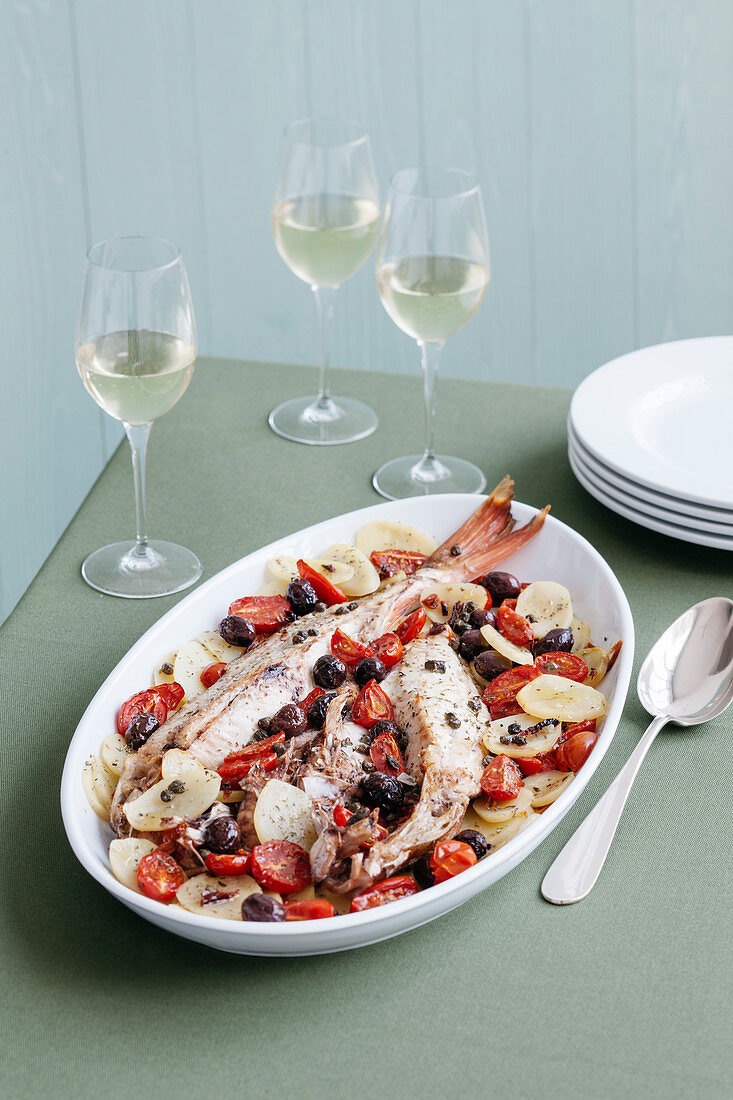 Oven-roasted gurnard with potatoes and cherry tomatoes