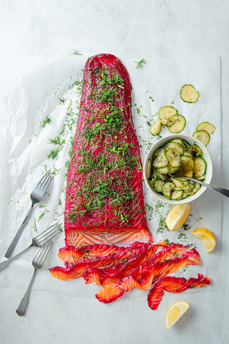 Gravlax, marinated salmon fillet with fresh dill and pickled cucumber salad