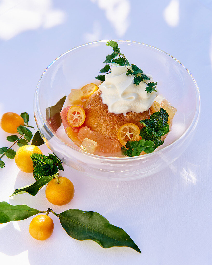Baba with citrus fruits and cream