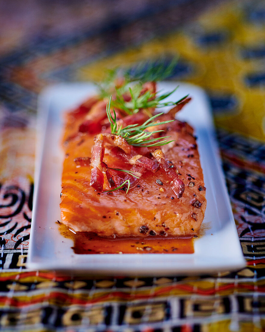 Caramelised salmon with cider and bacon