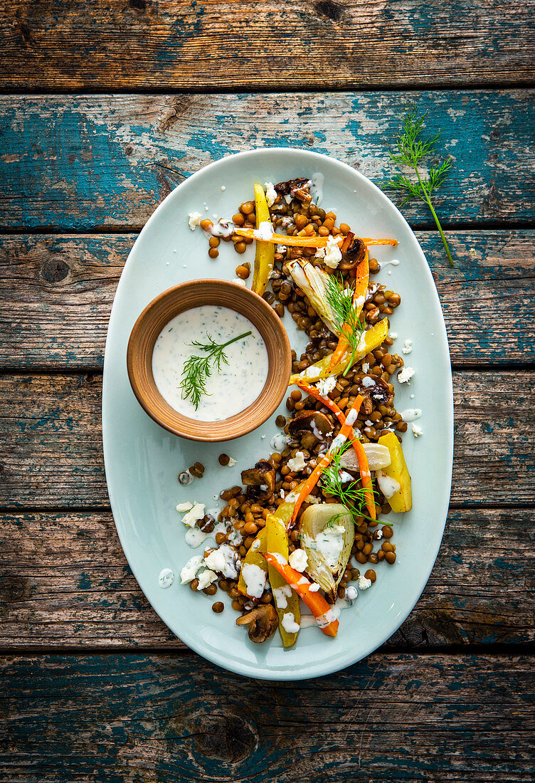 Lentils with oven-roasted vegetables, feta cheese and yoghurt