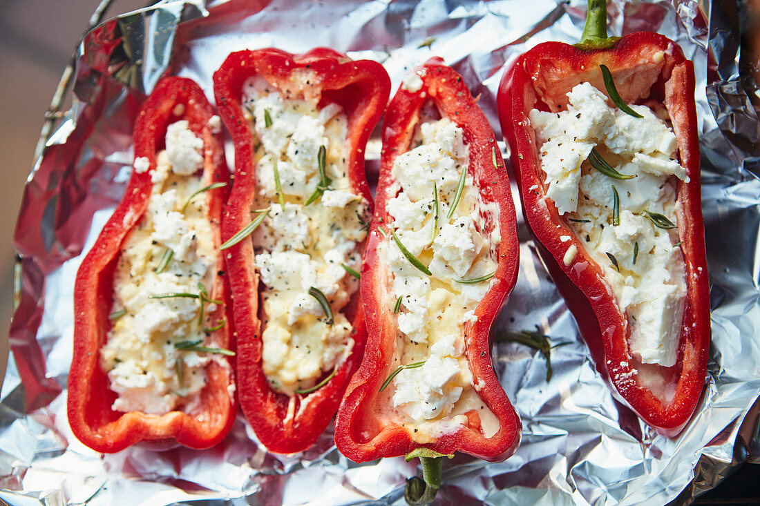 Grilled red pointed peppers filled with feta cheese and rosemary