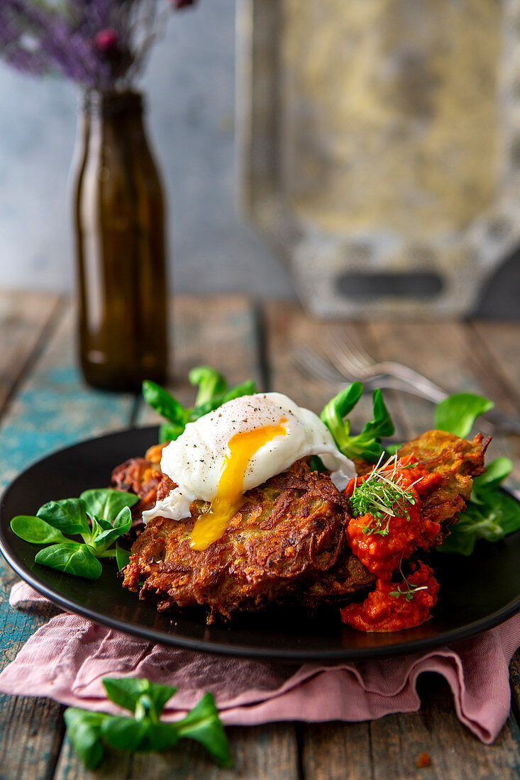Potato cakes with Parmesan cheese, ajvar and a poached egg