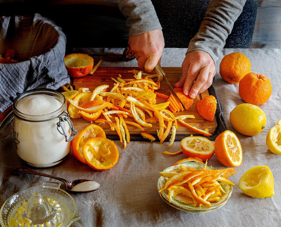 Preparing orange jam: cutting the orange peel into strips