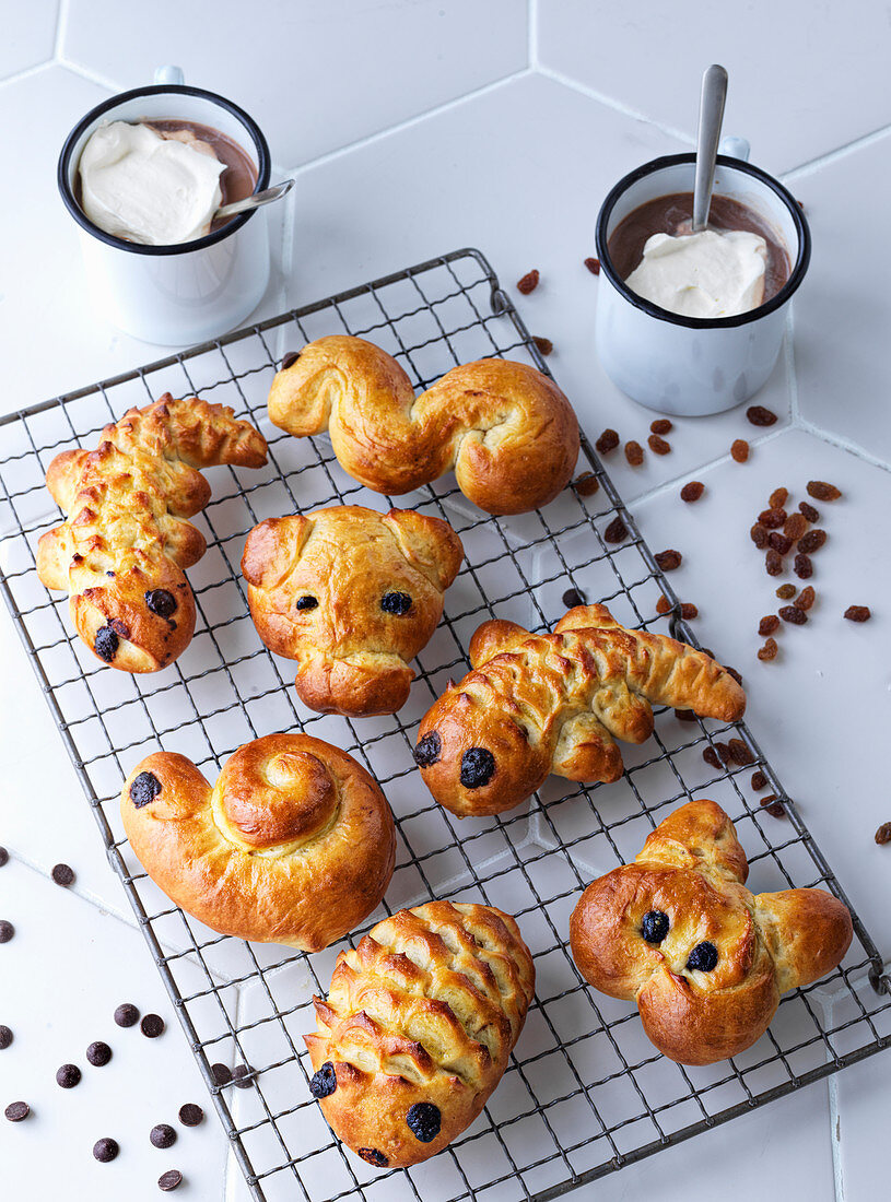 Animal-shaped bread for children and hot chocolate
