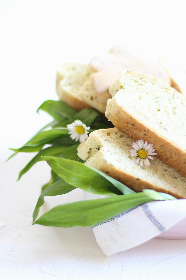 Fresh wild garlic, white bread and daisies