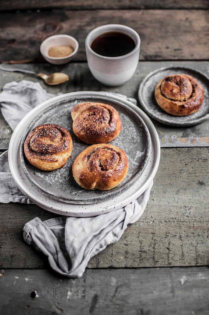 Kanelbullar - Swedish cinnamon buns served with black coffee