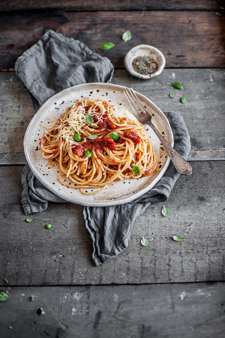 Spaghetti with simple tomato sauce, parmesan cheese and fresh basil