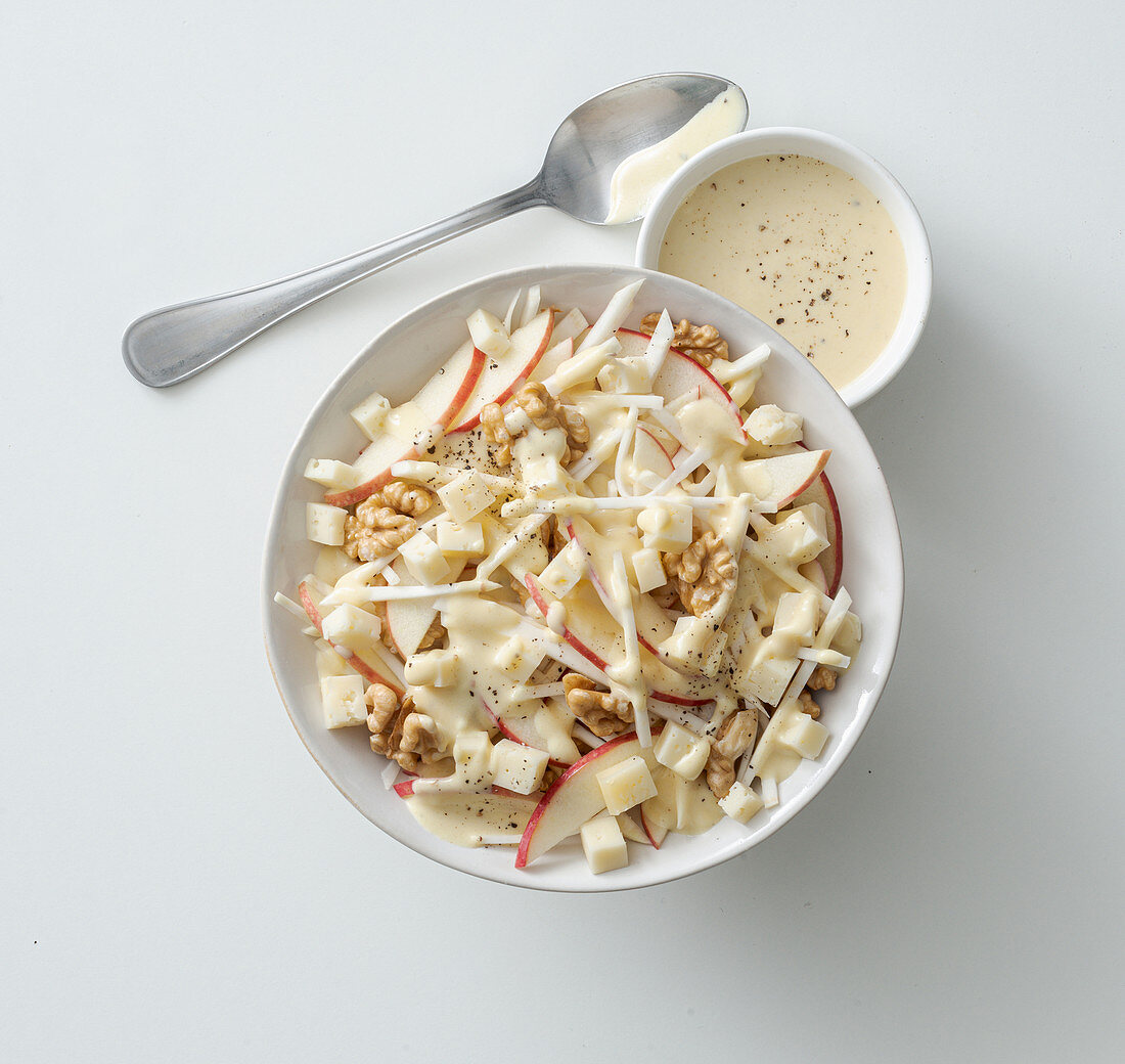 Celery and apple salad with cheese, walnuts and honey and mustard sauce