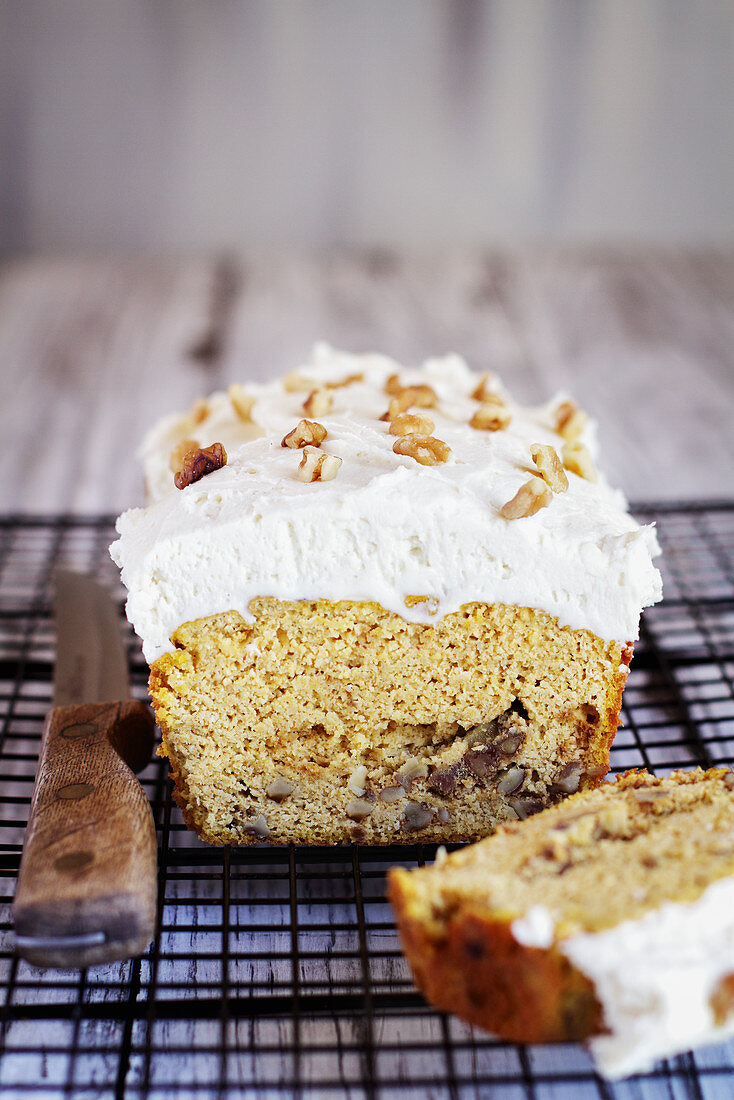 Keto Carrot Cake with almond flour and walnuts and frosted with a sugar free cream cheese frosting