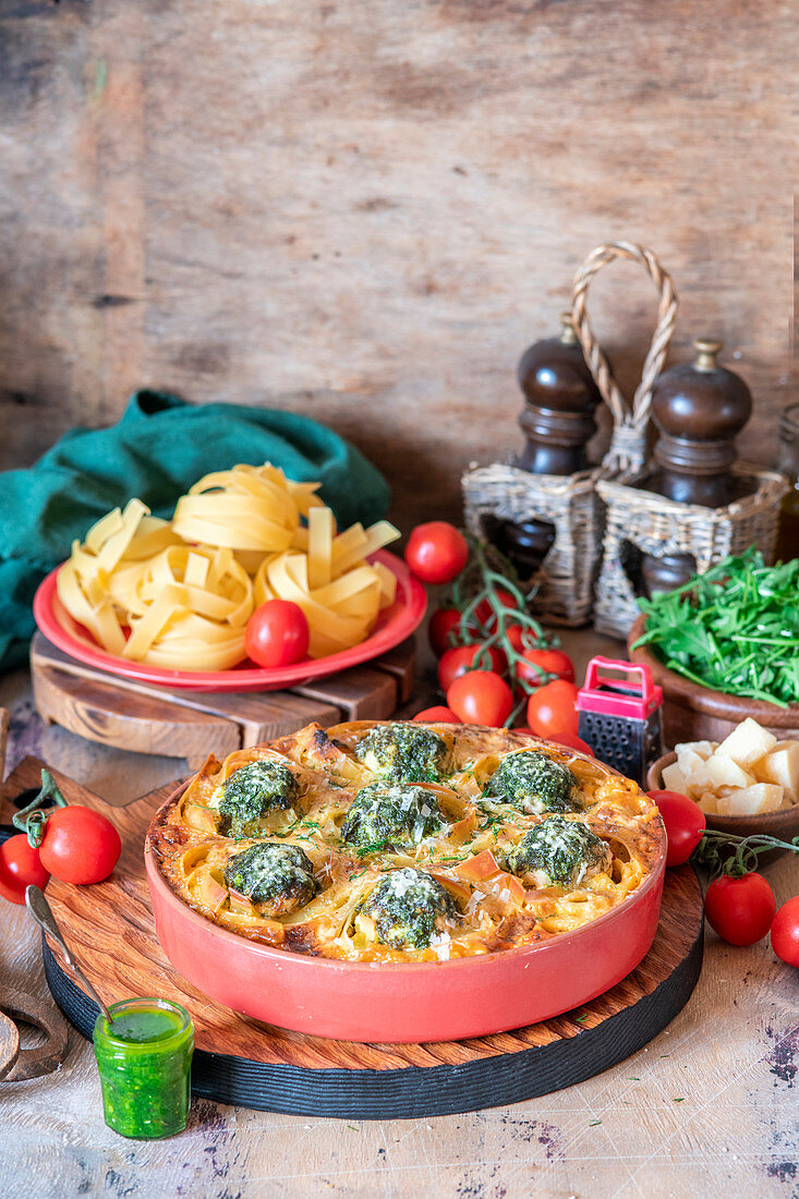 Pasta nests baked with meatballs, peasto and creamy tomato sauce