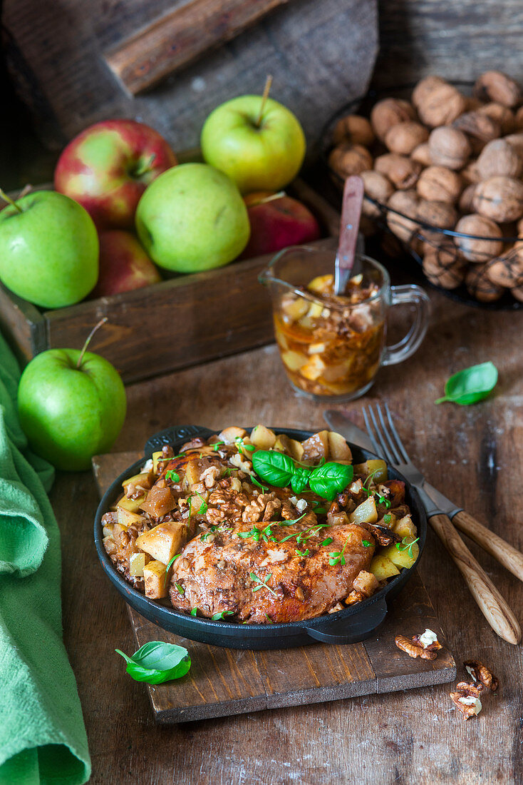 Chicken breast baked with apples and walnuts