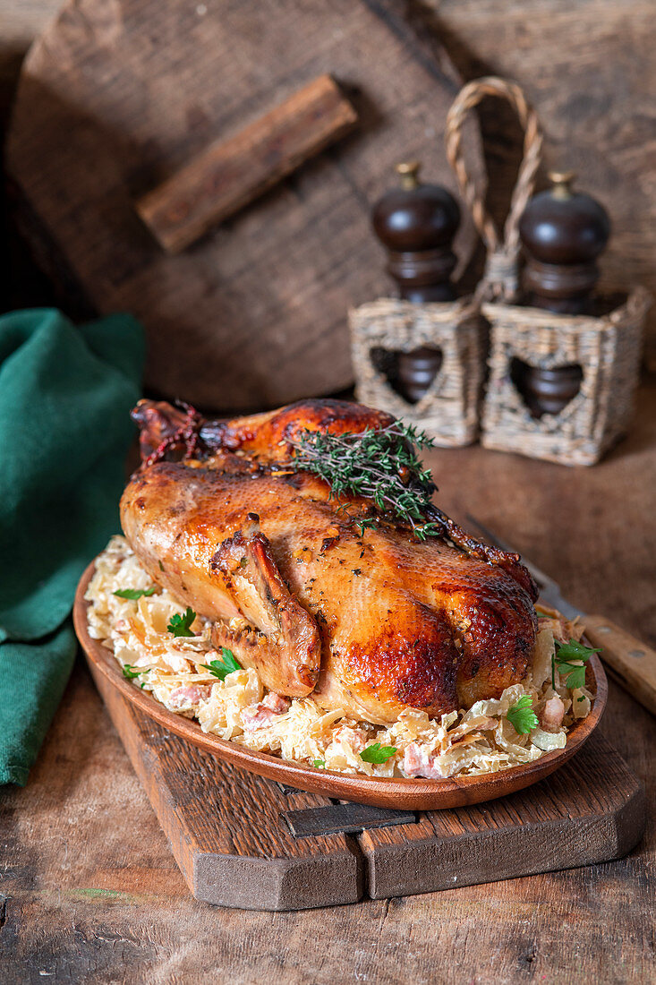 Roast duck with cabbage, bacon and cream