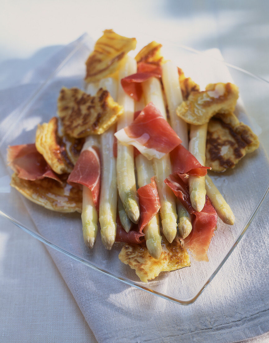 White asparagus with cured ham and pancakes