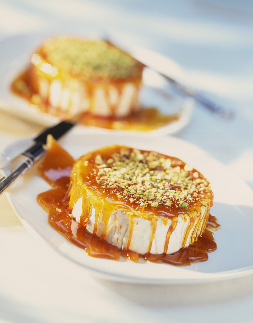 Camembert with a caramel sauce and pistachio nuts