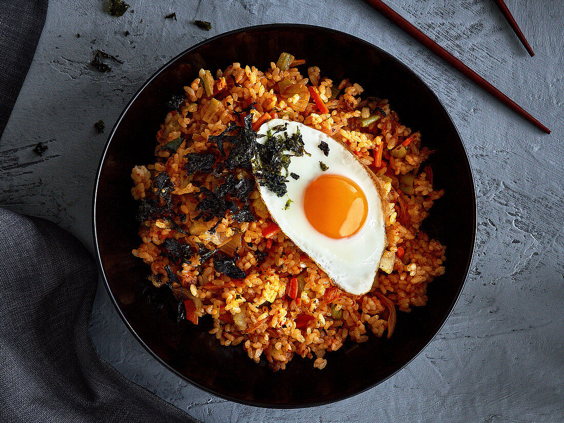 Fried rice with kimchi, vegetables and fried egg (Korea)