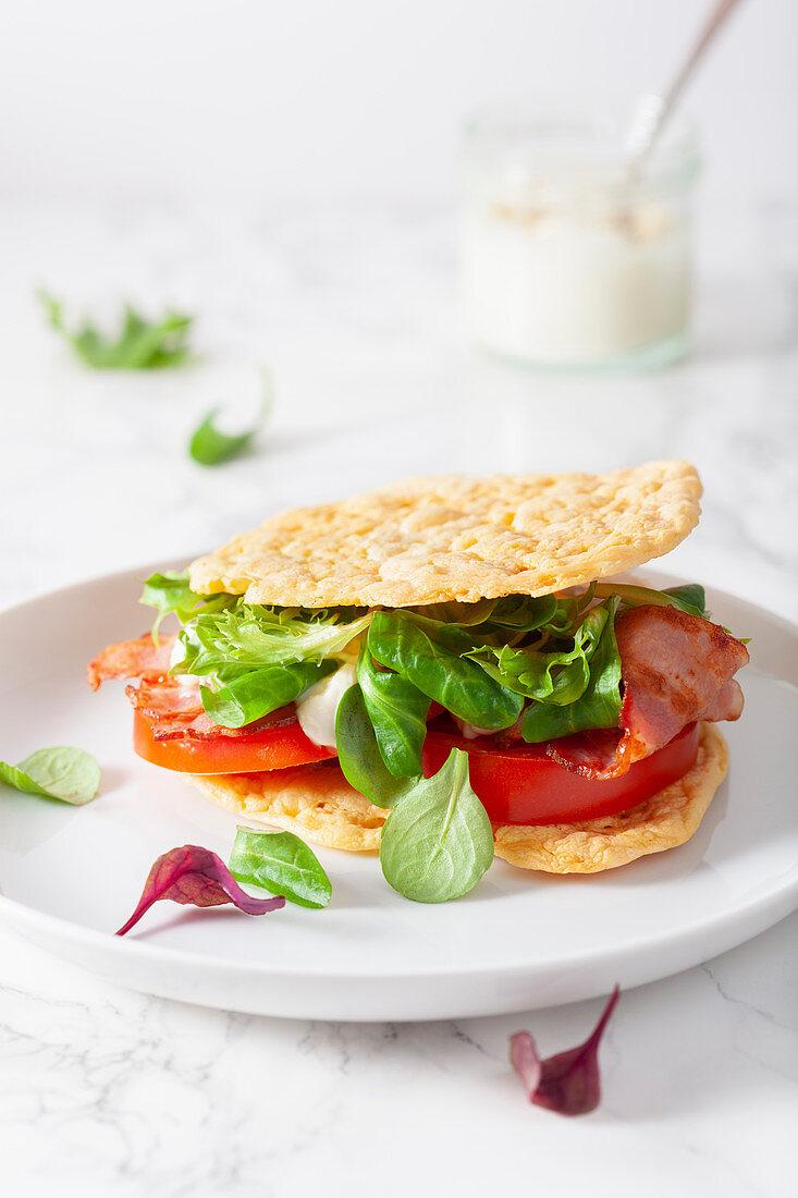 A bacon, lettuce and tomato sandwich on cloud bread (keto cuisine)