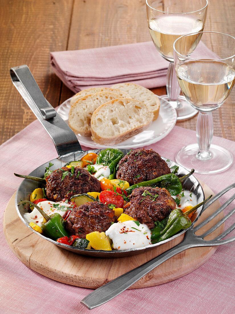 Meatballs with pimientos de padrón and buffalo mozzarella