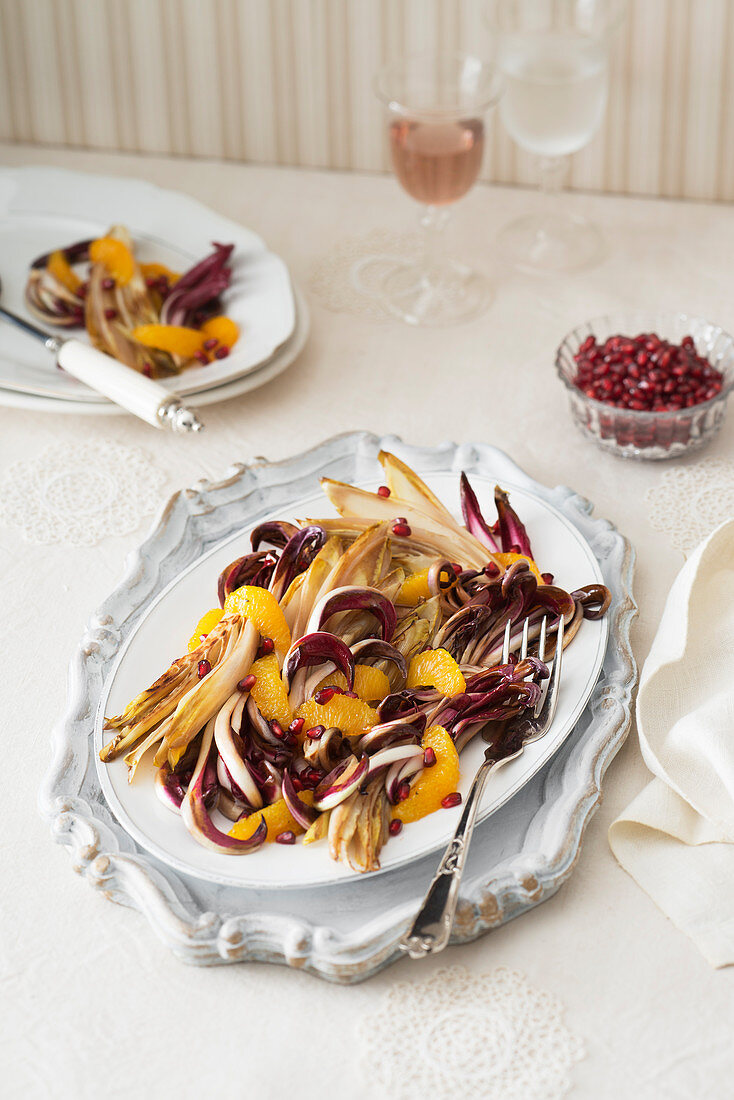 Radicchio and chicory in an honey and orange sauce with pomegranate seeds