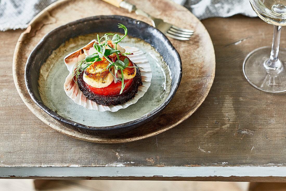 Seared Scottish scallops, black pudding, watermelon, radish, and pea shoots