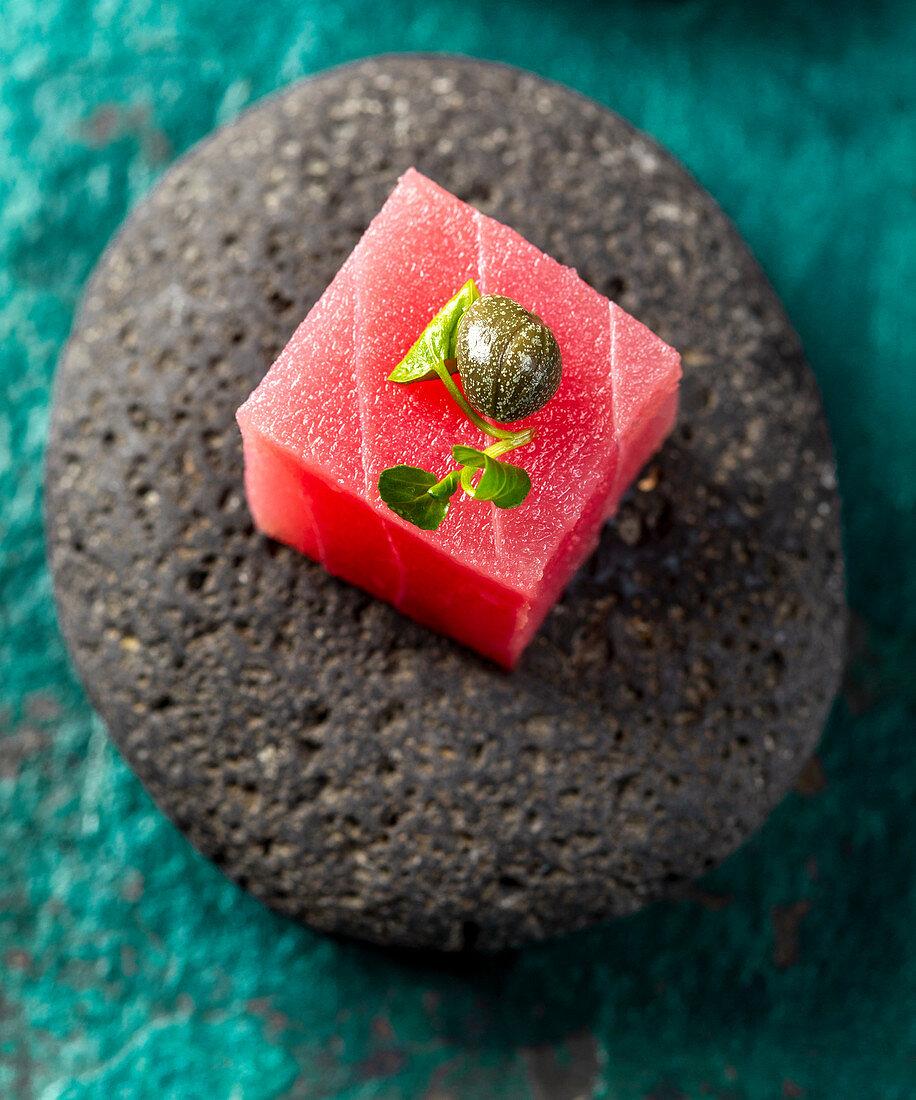Tuna sashimi with capers and cress salad