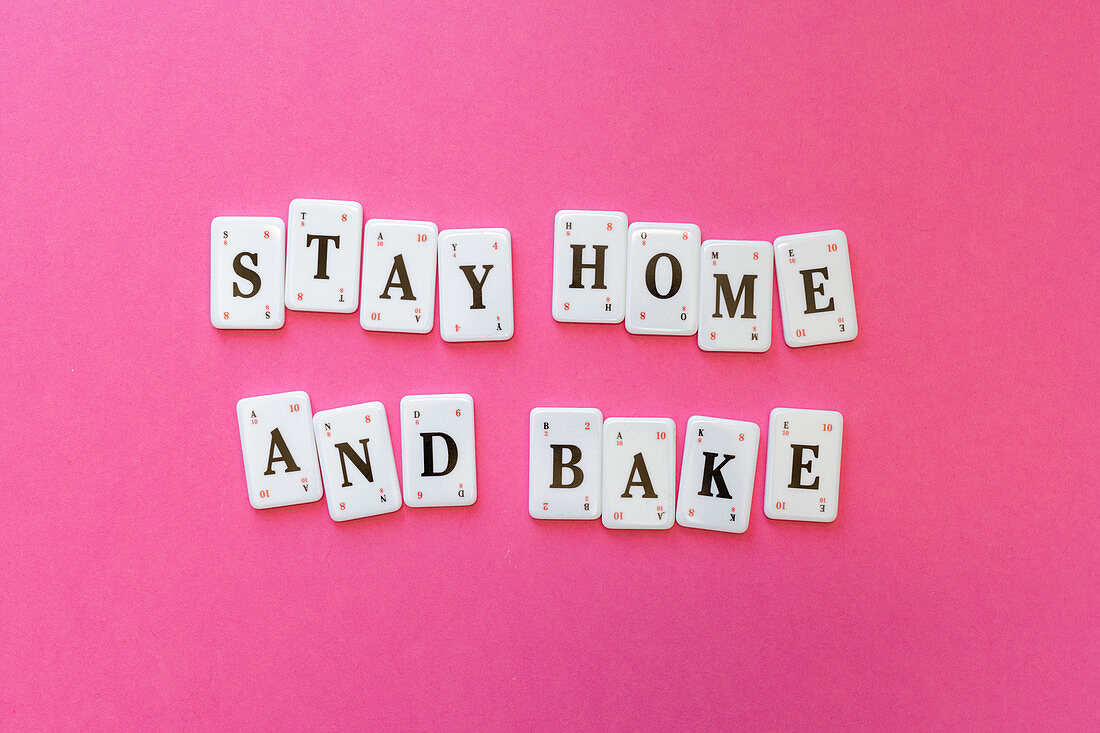 The words 'Stay Home And Bake'