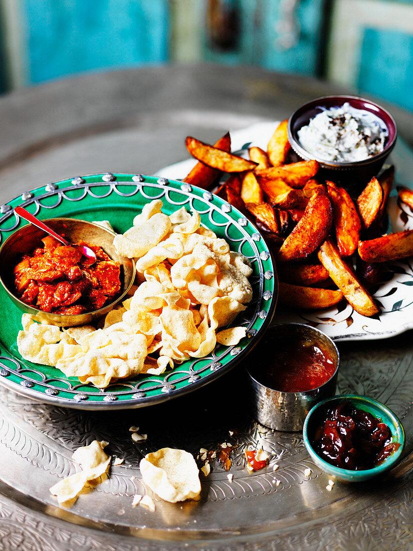 Potato wedges, poppadoms and mango chutney