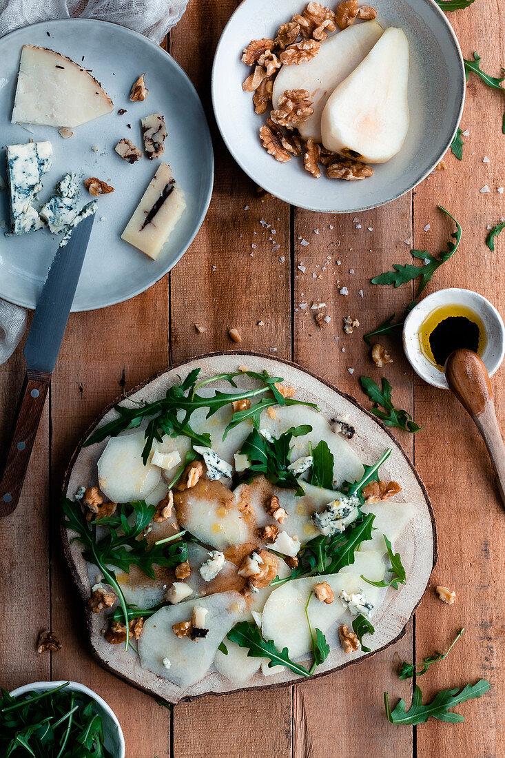 Pear salad with arugula, cheese and walnuts