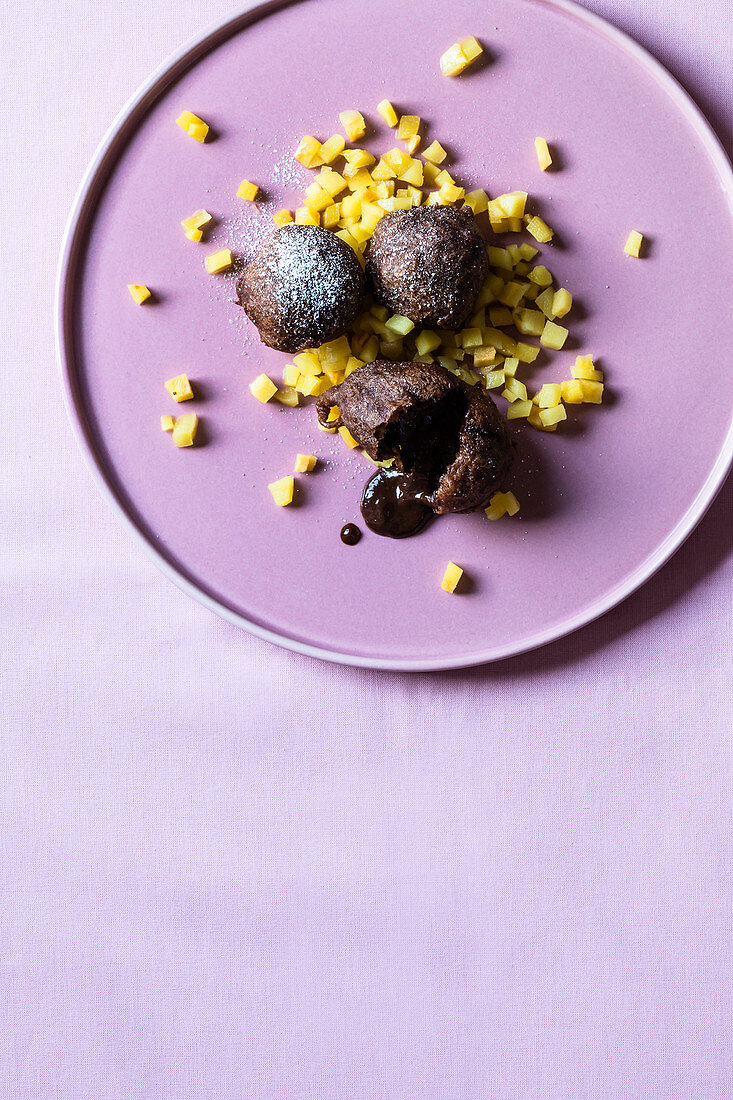 Chocolate doughnuts with quinces