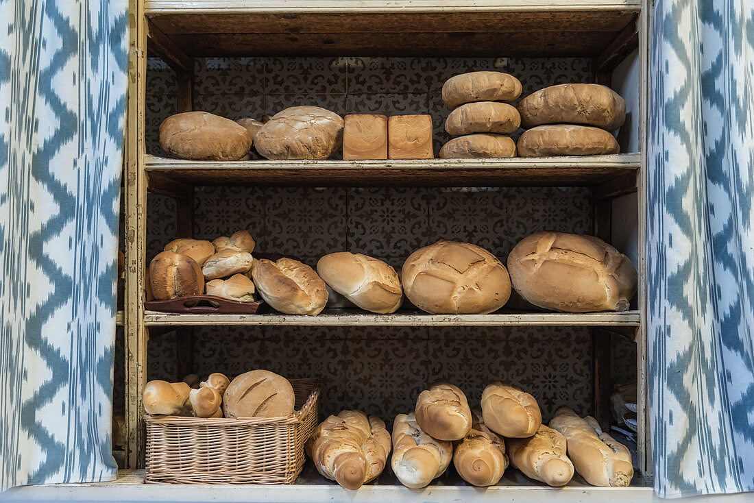 Breads and rolls on shelves