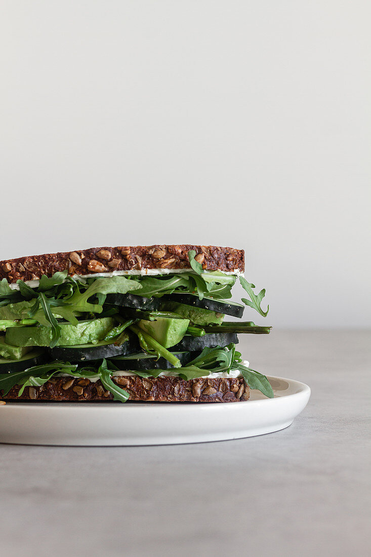 Healthy sandwich with green vegetables and herbs