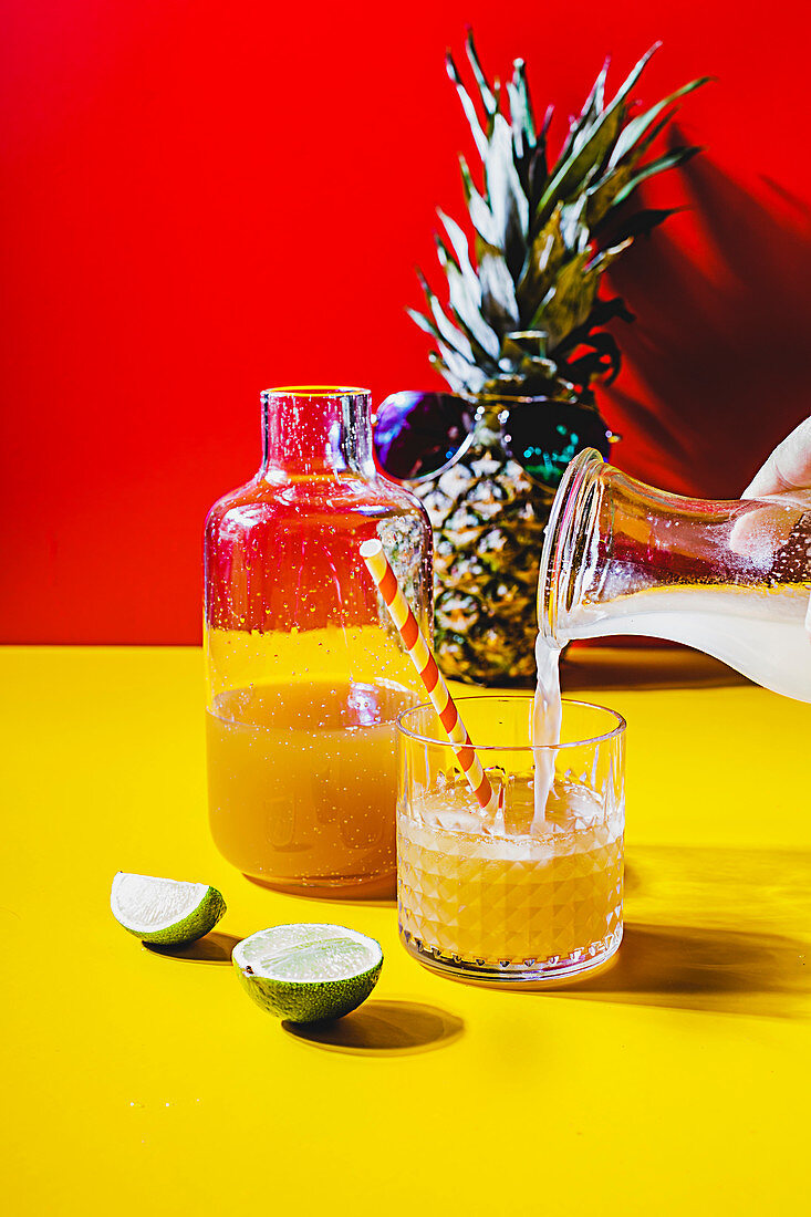 Iced tea with pineapple and coconut syrup poured into a glass