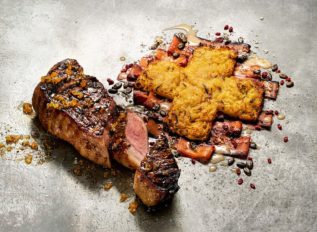 Grilled sirloin steak with hash browns and marinated carrots