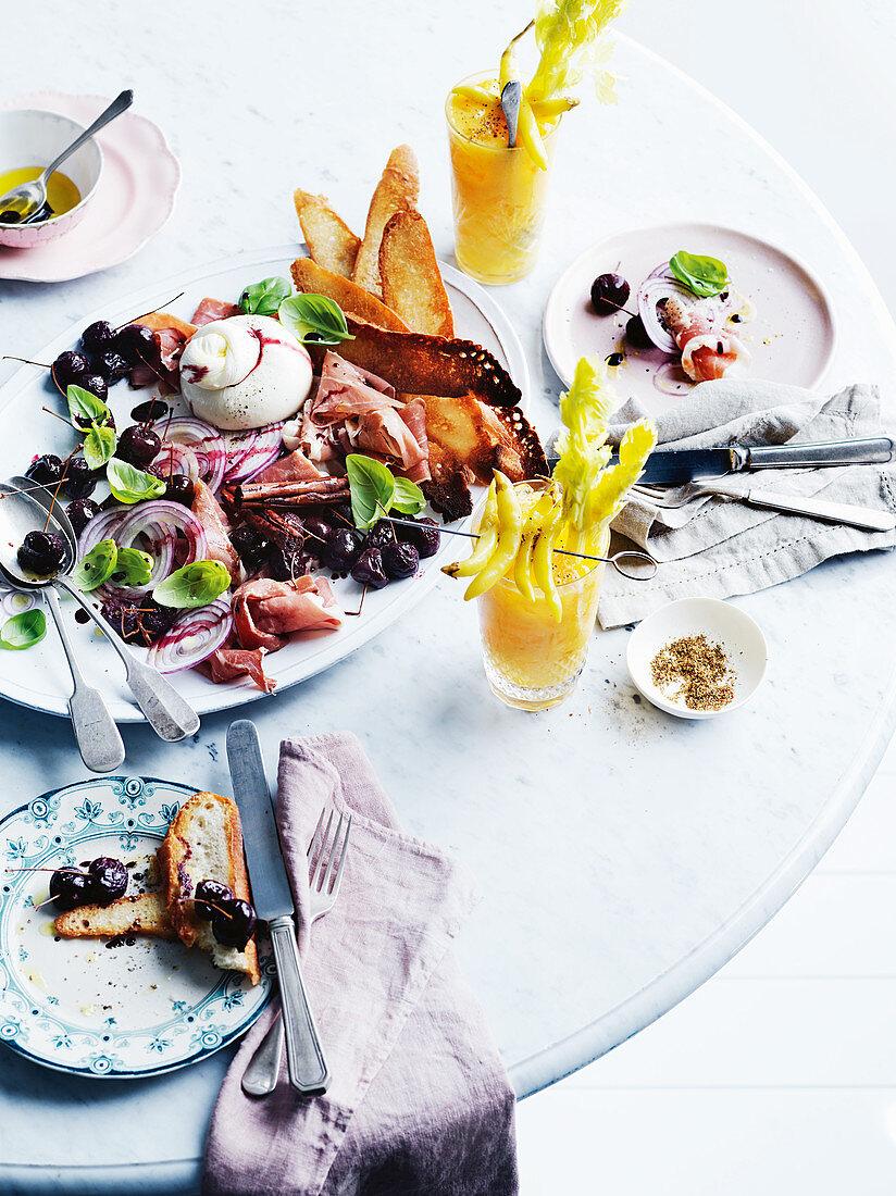 Burrata, mulled cherries, prosciutto, basil salad and 'Mango Mary'