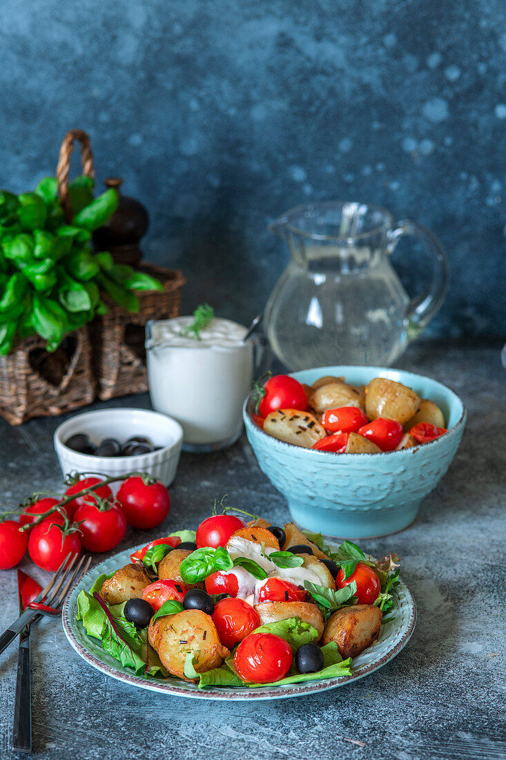 Fried potato, roasted cherries and olives salad