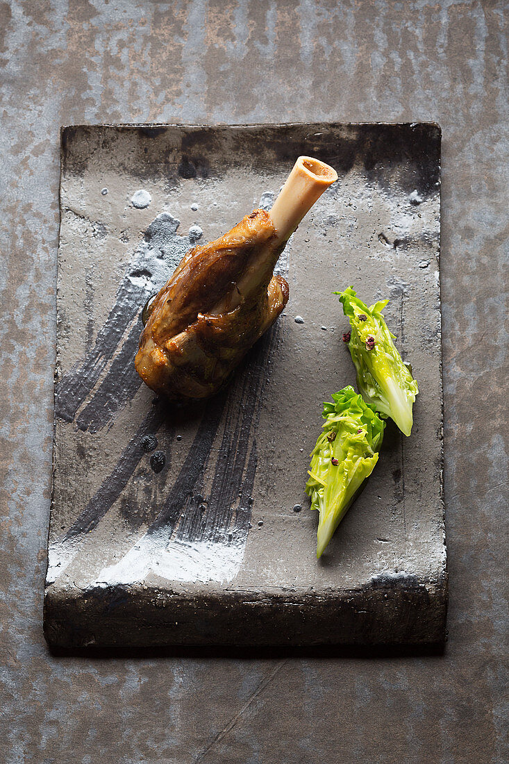 Sichuan-style lamb knuckle with sweet-and-sour lettuce