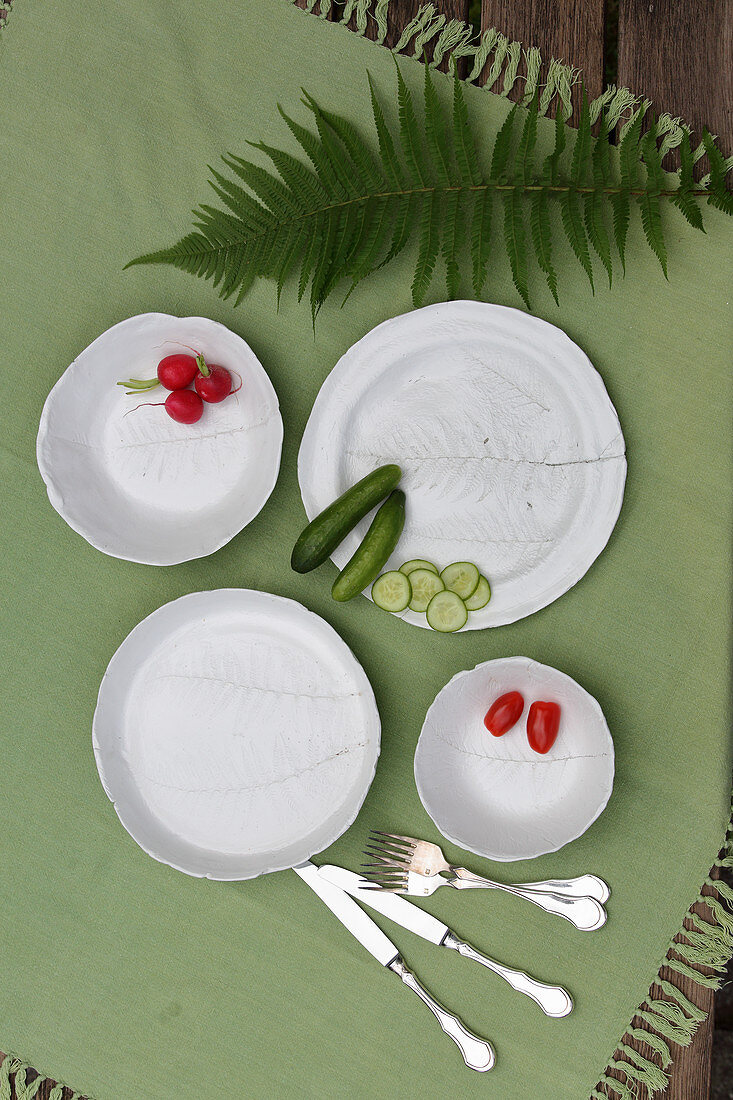 Plates decorated with fern motifs