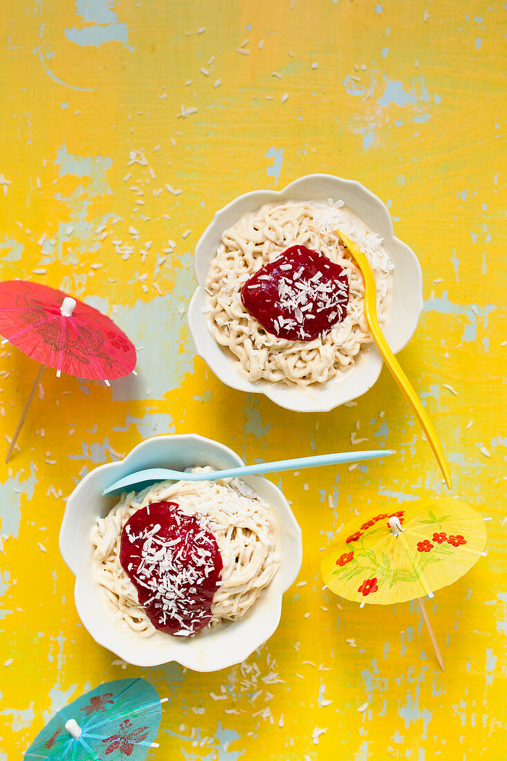 Vegan banana spaghetti ice cream with raspberry sauce