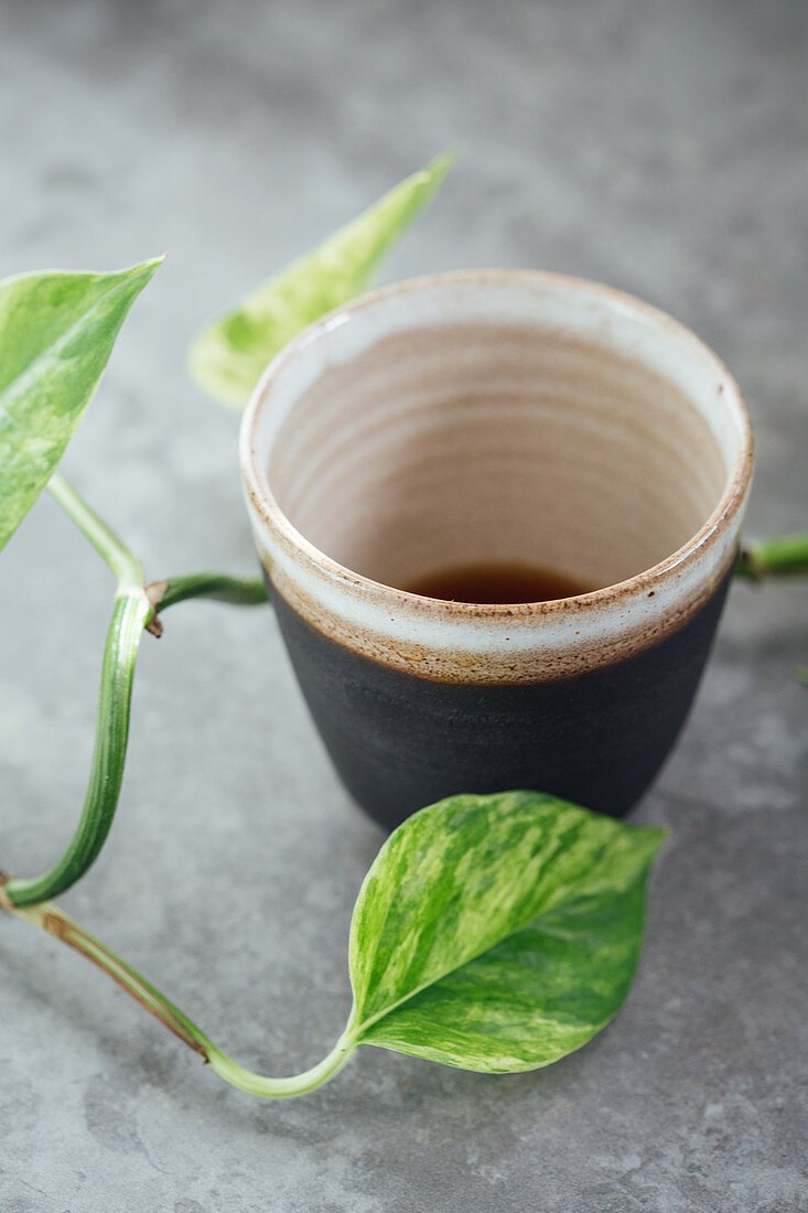 Black coffee in a handmade black clay cup