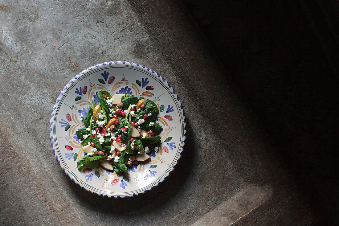 Pomegranate winter salad with feta, hazelnuts, spinach and pear