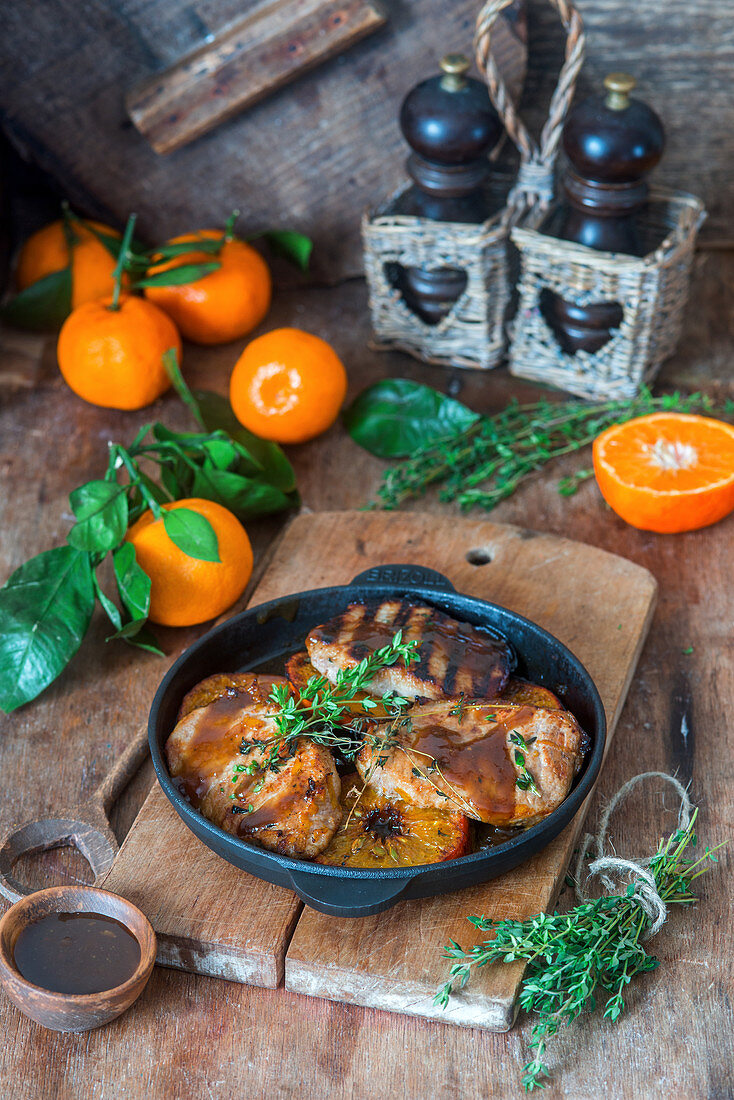 Pork chops with tangerines and honey soy sauce