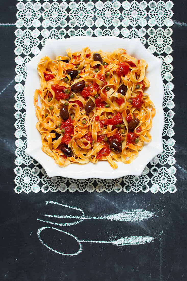 Ribbon pasta with tomato sauce and olives
