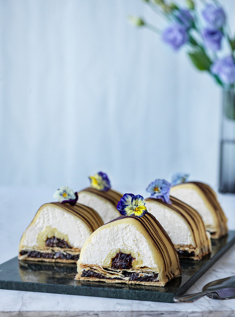 Plum and cream slices with marzipan and chocolate icing