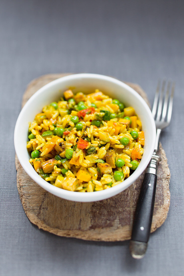 Vegan curry rice with vegetables and tofu