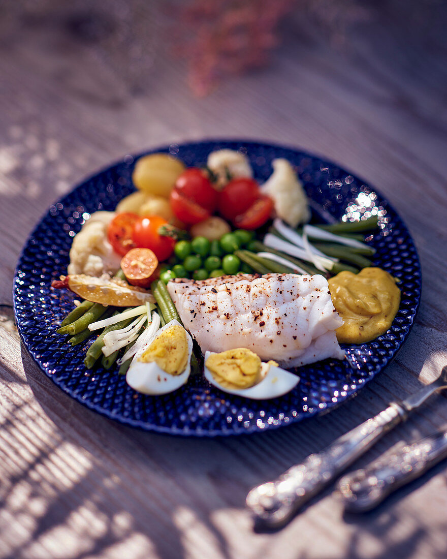 Monkfish fillet with vegetables, egg and aioli