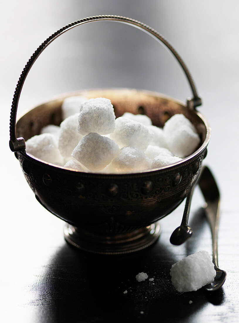 Sugar lumps in sugar bowl