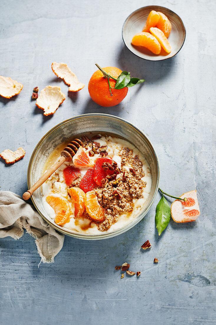 Fresh grain muesli with clementines, blood orange and pecans