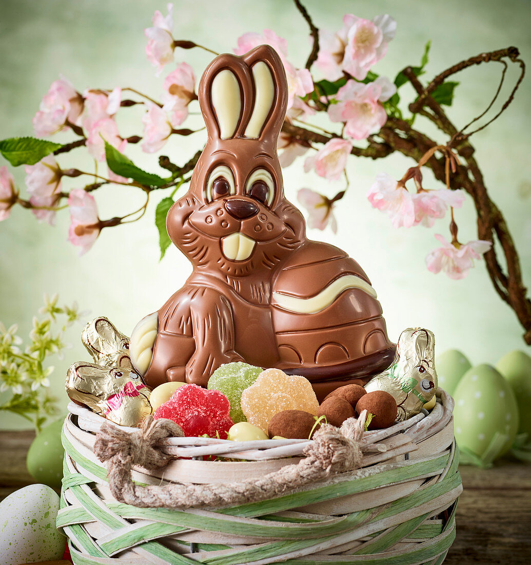 Chocolate bunny and sweets in an Easter basket