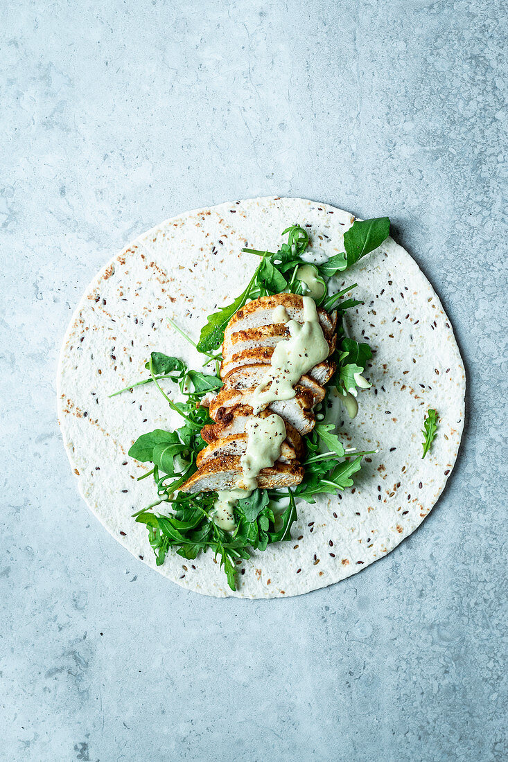 Wrap with chicken breast, arugula and honey mustard sauce